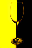 wine glass with yellow and black lighted background poster