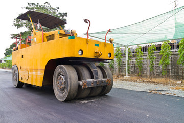 Steamroller on asphalt road