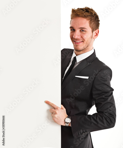Businessman showing a white board