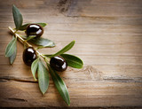Olives on a Wood background - 38981024
