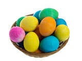 Round wicker basket of dyed eggs poster