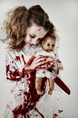Girl Child Ghost or Zombie Covered in Blood with Knife and Baby