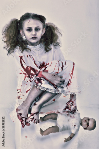 Girl Child Ghost or Zombie Covered in Blood with  Baby Doll