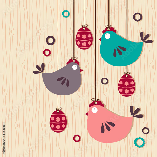 hanging easter chickens on wooden background