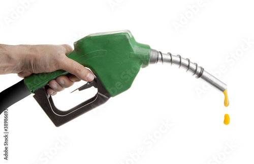 gas pump isolated on white with one last drop of fossil fuel