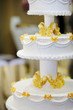 Delicious white and yellow wedding cake