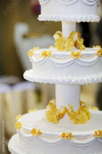 Delicious white and yellow wedding cake