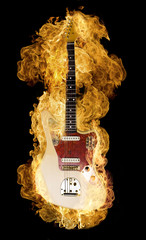 Classic electric guitar burning on black