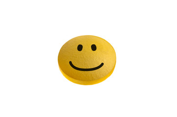 Yellow pill with happy face on  isolated on white