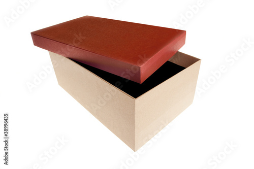 Gift box with red cover open isolated on white