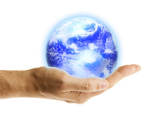 Glowing blue earth in a hand on white background