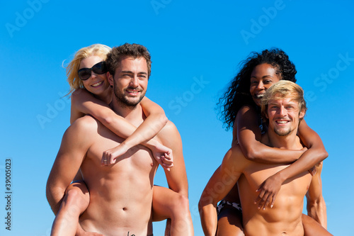 Friends in vacation at the beach