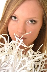 Businesswoman with paper shreds