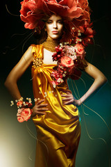 sensual beautiful woman in long yellow dress and flowers