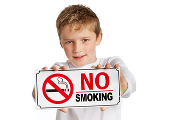 Boy with no smoking sign