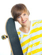 Portrait blond boy with skateboard