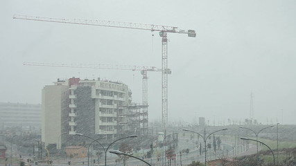 Crane paused, bad weather, heavy snow
