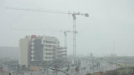 Crane paused, bad weather, heavy snow