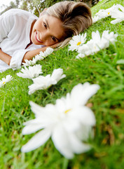 Woman lying on a floral garden