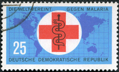 GERMANY - CIRCA 1963: shows map, cross and staff of Aesculapius