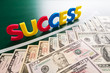 Colorful success words and growing US dollars