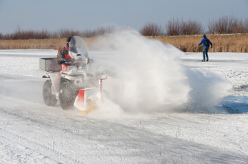 quad cleaning the ice