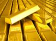 Stacks of gold bars close up