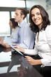 Confident latin businesswoman in office