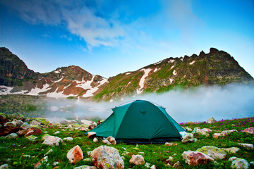 Tent near mountain lake