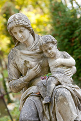 Monument of the woman with the child on a cemetery