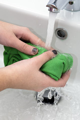 Washing hands in bathroom with  hot water