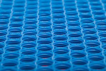 Blue and red plastic caps background