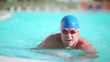 Young swimmer in breaststroke; Full HD Photo JPEG