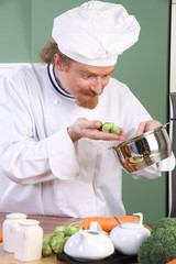 Funny young Chef with Brussels sprouts