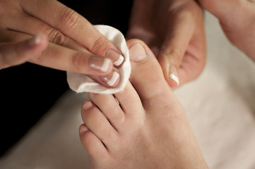 toenail polish being removed