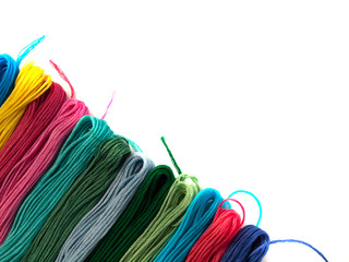 Colorful embroidery thread isolated on white