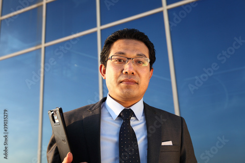 young businessman holding document
