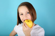 Girl eating a yellow apple
