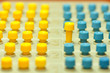 Pegs of logic game ordered in rows for different concepts.