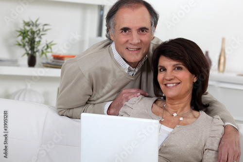 Middle-aged couple with laptop