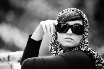 Elegant girl with sunglasses and leopardskin foulard