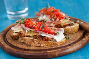 Delicious Bruchetta with ham and tomato