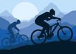 Mountain bike bicycle riders in wild mountain nature landscape