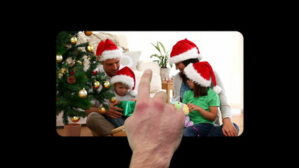 Hand activating christmas videos
