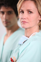 female doctor and his colleague with a serious air