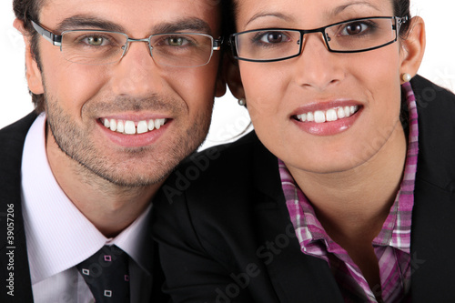 Smiling man woman wearing pairs of eyeglasses