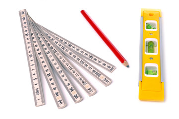 measure, pencil and bubble level