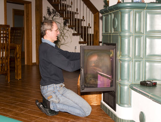 Mature men heating in tiled stove