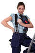 cute teenage apprentice holding electric drill