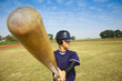 baseball player holding baseball bat